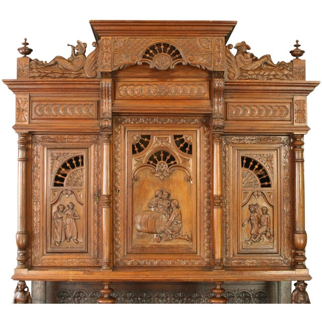 This elaborate Antique Brittany-Style Buffet from France dates to 1880. It has chestnut hand-carved scenes of rural life...