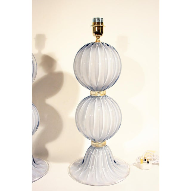 An elegant pair of pearl grey blown Murano glass with gold rings with gold inclusions table lights. Signed by Alberto Dona...