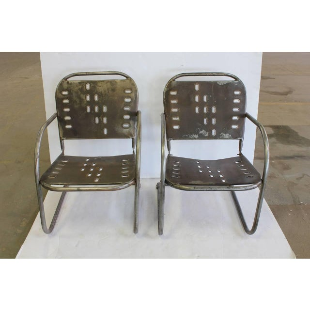 Mid-Century garden metal lounge chairs.