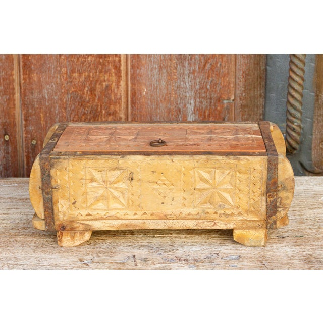 A charming handmade decorative box, with a whitewash finish, it features lovely tribal star carvings on its top and sides,...