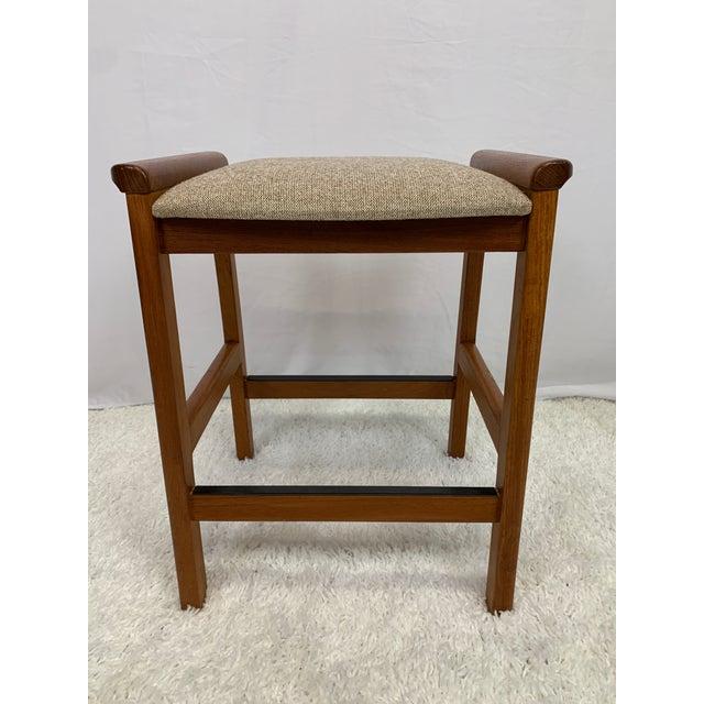 A beautiful vintage Danish Modern stool by J.L. Møller for Højbjerg of Denmark. Solid teak frames support a wide, sturdy...