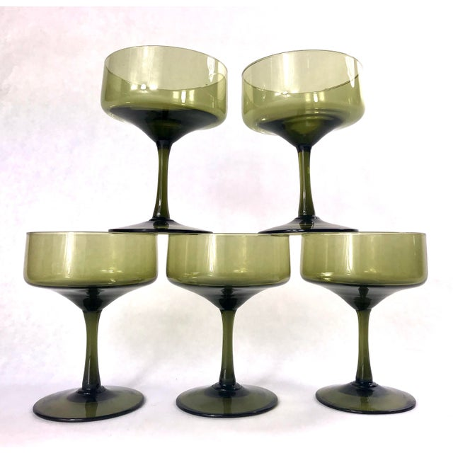 Wonderful set of champagne or cocktails glasses ready for holiday cheer. Glassware a deep green smoke color and squared...