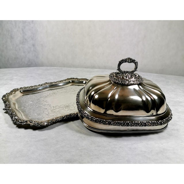 The dish cover rests on a rectangular shaped tray, as was in use in the early 1800s, the borders are embossed in silver...