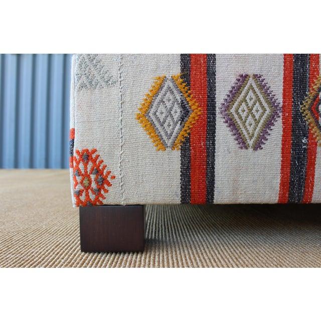 Orange Ottoman Upholstered in a Vintage Rug For Sale - Image 8 of 10