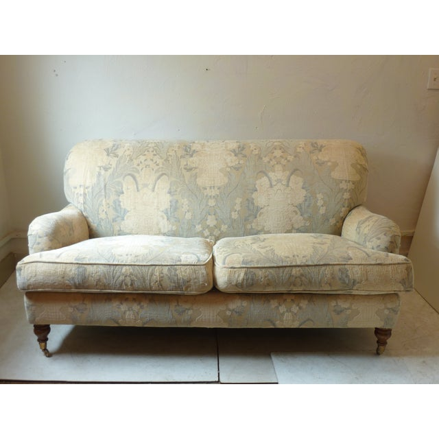 A. Rudin loveseat with down wrapped cusions, fabric with soft nap, colors range from gray-beige to warm beige and ivory....