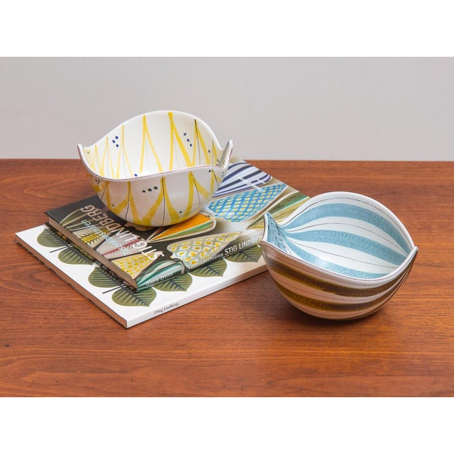 Pair of original Faience Leaf Bowls by Swedish designer Stig Lindberg for Gustavsberg. These playfully formed bowls have...