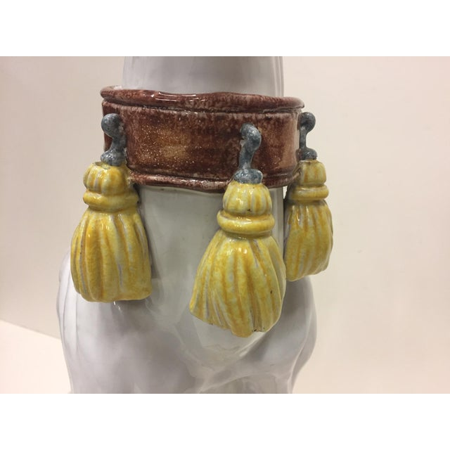 Sophisticated stylized sculpture of a greyhound dog having wonderful tassel adorned collar and color palette of white,...