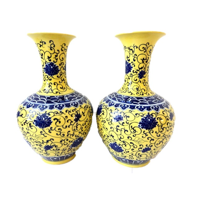 Vibrant and elegant Yellow and cobalt blue Chinese Famille Jaune Porcelain Onion Shape Pair of vases decorated with...