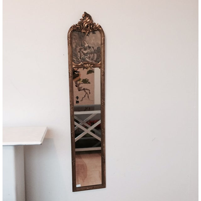 This mirror is long and thin with an etched scene in the top. Wonderful for an entry way or closet area. A great piece if...