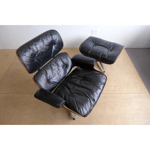 """Here is a beautiful rosewood lounge chair and ottoman by Ray and Charles Eames for Herman Miller, known as the """"670/671""""...."""
