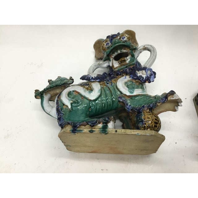 Early 20th Century Vintage Vietnamese Ceramic Foo Dog Figurines- A Pair For Sale - Image 11 of 13