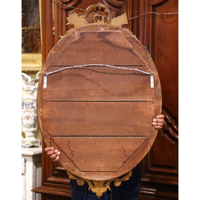 19th Century French Louis XVI Carved Giltwood Oval Wall Mirror With Torch Motif For Sale - Image 11 of 12