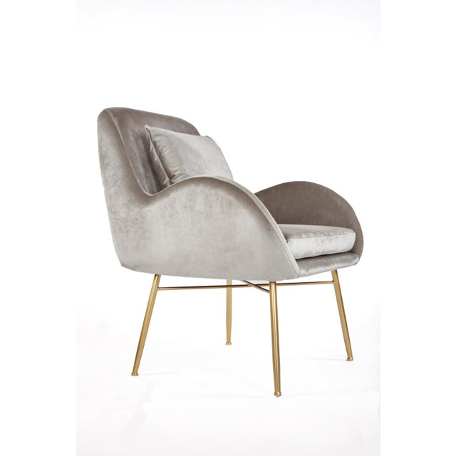 """Gray velvet club chair with gold legs comes with an accent pillow. Materials: Velvet, metal Measurements: 31.5""""d x 28.5""""w..."""