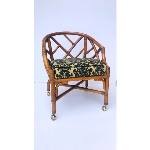 Fabulous Hollywood Regency Chinese Chippendale desk chair. Striking from all angles and easily swivels. Fitted with four...