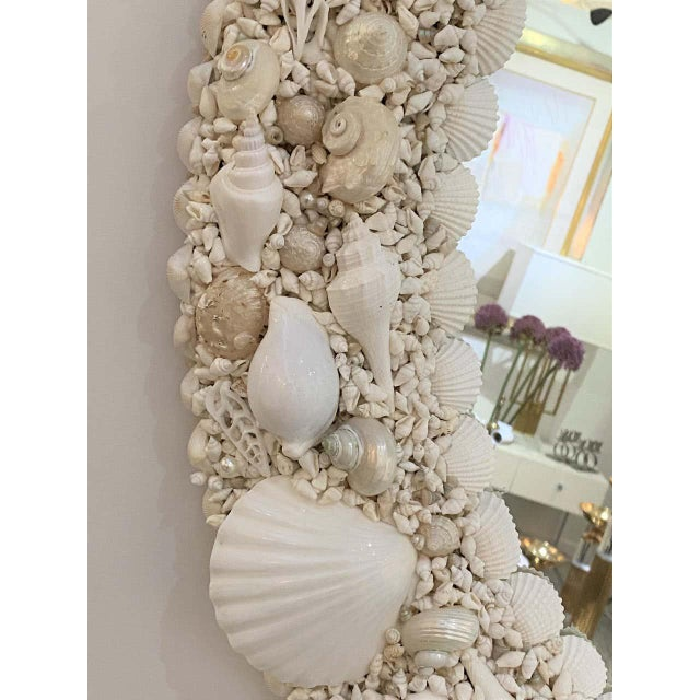 This stylish seashell encrusted mirror was designed and created exclusively for the Iconic Snob Galeries by a local Palm...