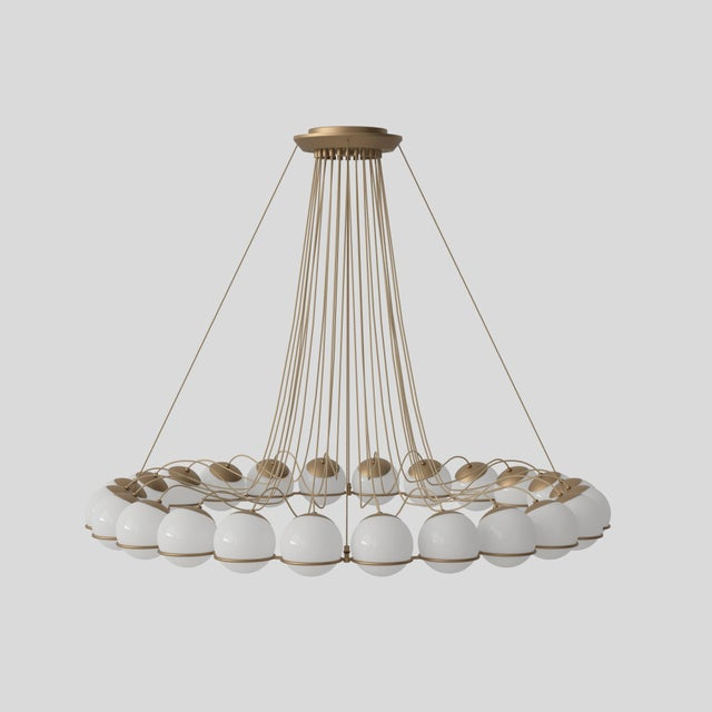 Gino Sarfatti Model 2109/24/14 chandelier in champagen. The Le Sfere collection is the largest product family by Gino...
