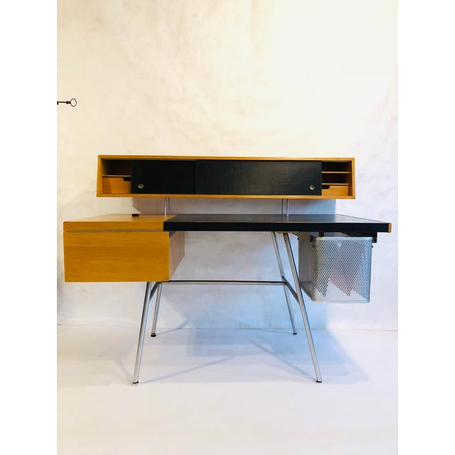 1950's Home Office Desk designed by George Nelson for Herman Miller. Leather writing surface, ash wood, metal file basket...