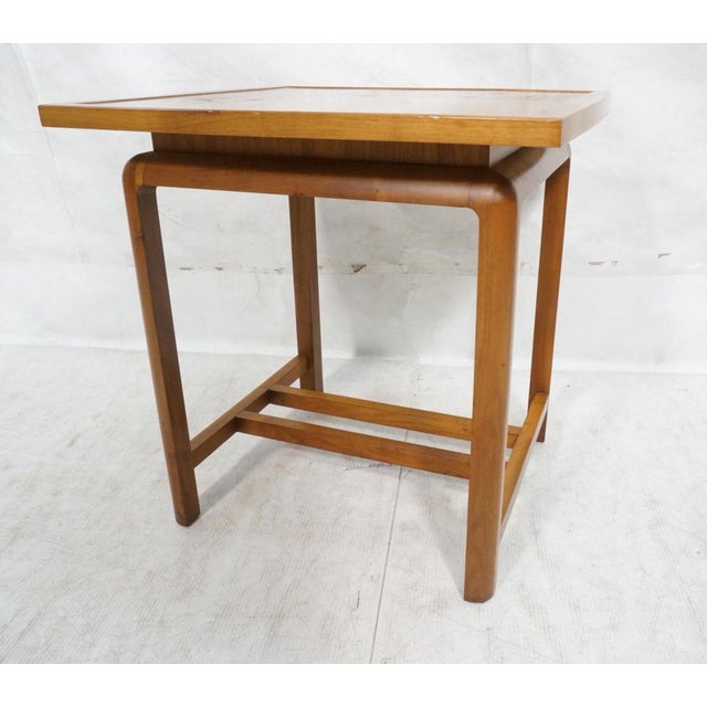 Walnut floating top table in the manner of Jens Risom. Marked '531'. Beautiful table with one small nick in side of table...