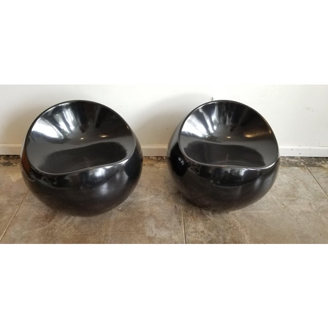 Pair of contemporary black pebble stools great for accent seating.