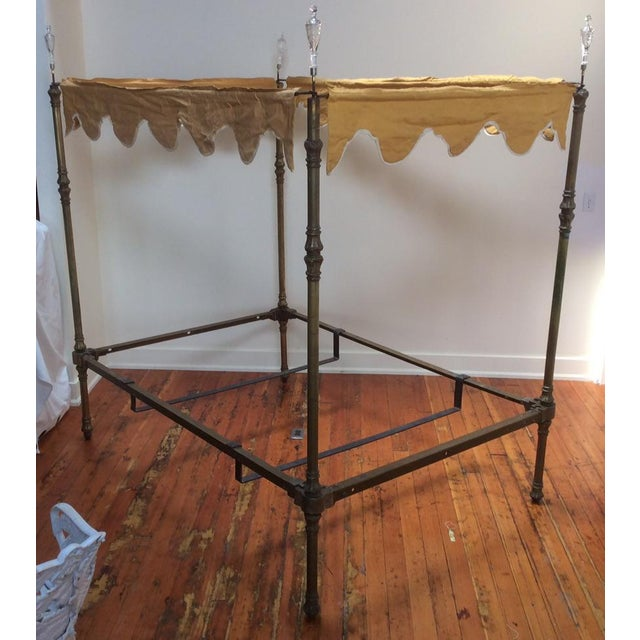 Fantasy four poster brass bed with yellow scalloped canopy and blown glass cut crystal finials. Can be dressed up under...