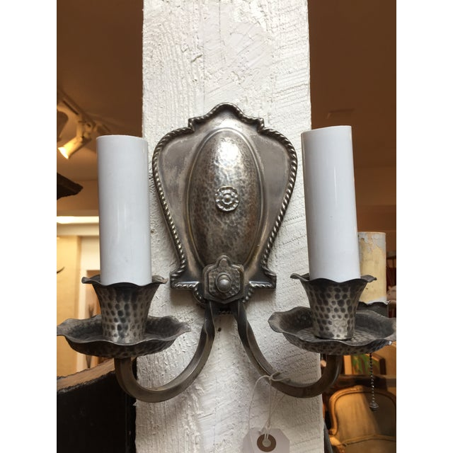 A beautiful pair of hand hammered aluminum sconces. They are in great shape and very unique. Their is also an on/off...