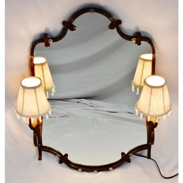 Vintage Tole Style Lighted Wall Mirror Condition consistent with age and history. Minor scratch to mirror. Please use zoom...