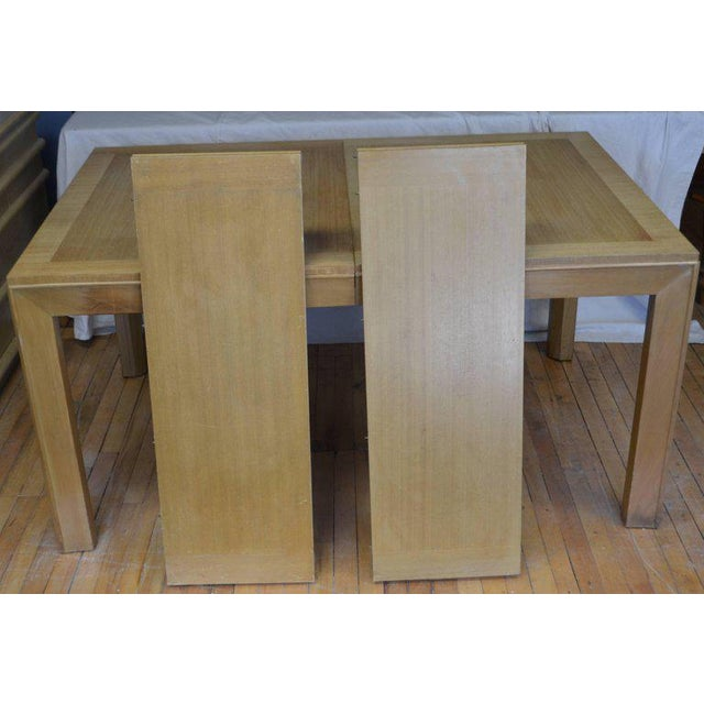 Dining table of blonde maple with two leaves designed by Robsjohn-Gibbings for Widdicomb, circa 1948. Top has been...