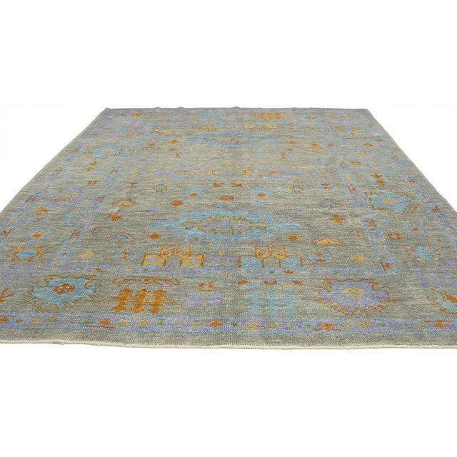 52231, contemporary Turkish Oushak rug with modern style and bright colors. This contemporary Turkish Oushak rug with...