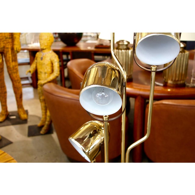A nice vintage Reggiani floor lamp with four heads. It is brass-plated, and the bottom plate was worn. Please note that...