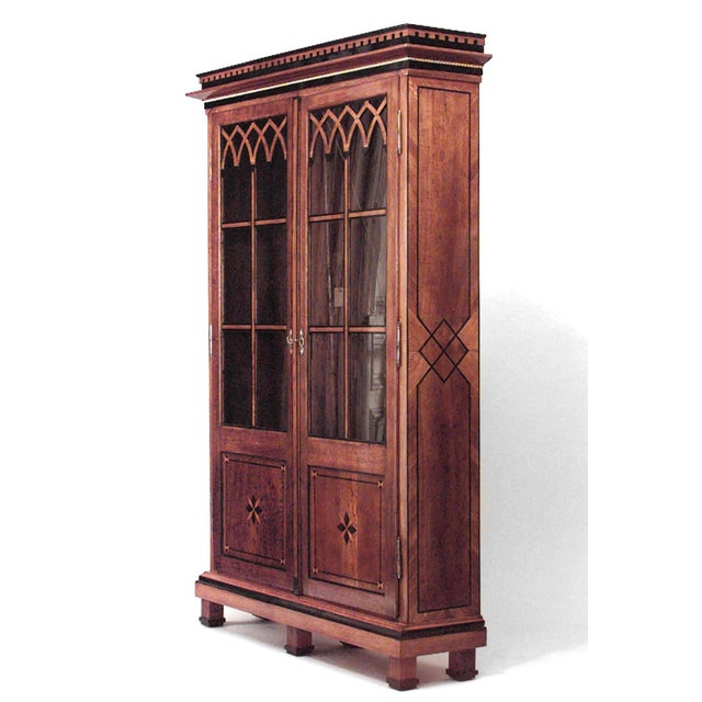 Continental Austrian neoclassical style oak bookcase cabinet with geometric inlay, gilt egg-and-dart detail, ebonized...