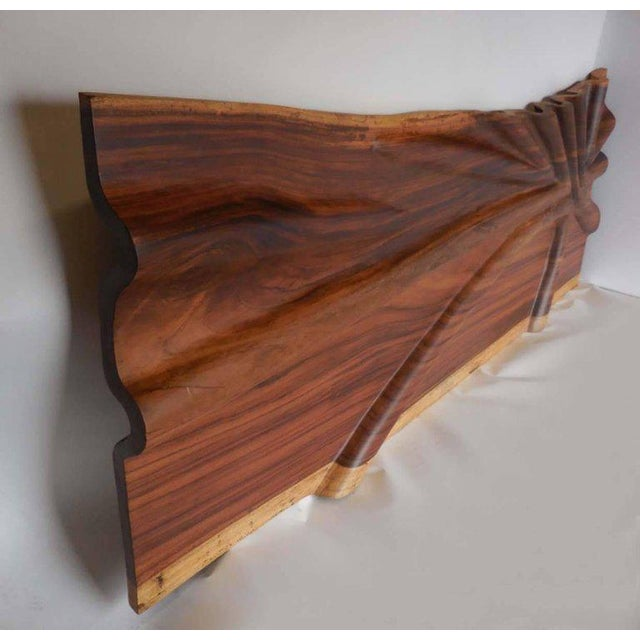 Hand-carved tropical wood sculpture or headboard with undulating design. Live edge conacaste wood with natural variegated...