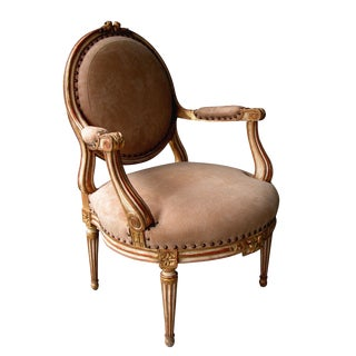 A Large-Scaled French Louis XVI Style Ivory Painted and Parcel Gilt Oval Back Open Armchair For Sale