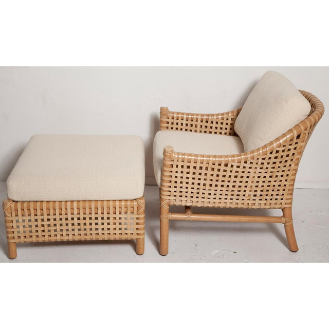 An eye-catching vintage lounge chair and ottoman set by McGuire made entirely of rawhide leather straps woven onto a thick...