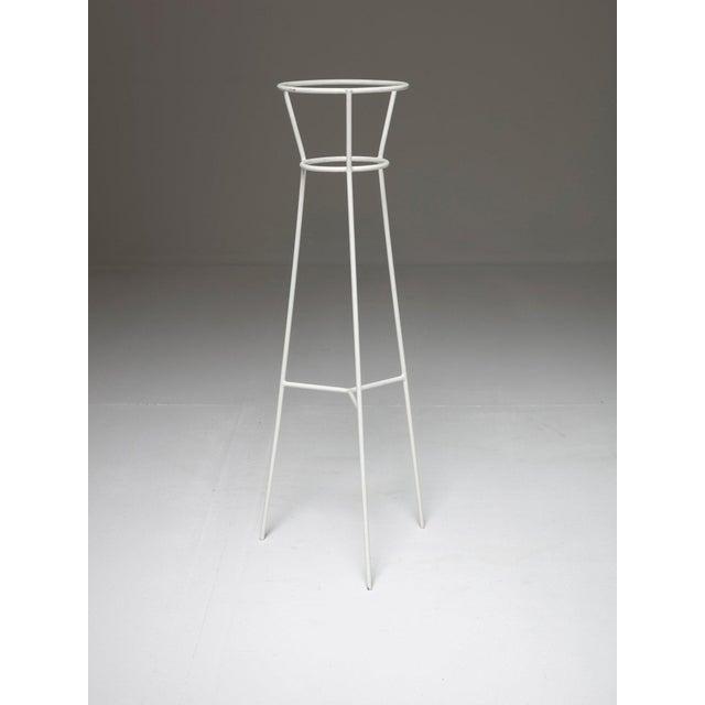 "Metal plant holder designed by Ignazio Gardella Part of the ""Casa nel Parco"" interior design furnishing."
