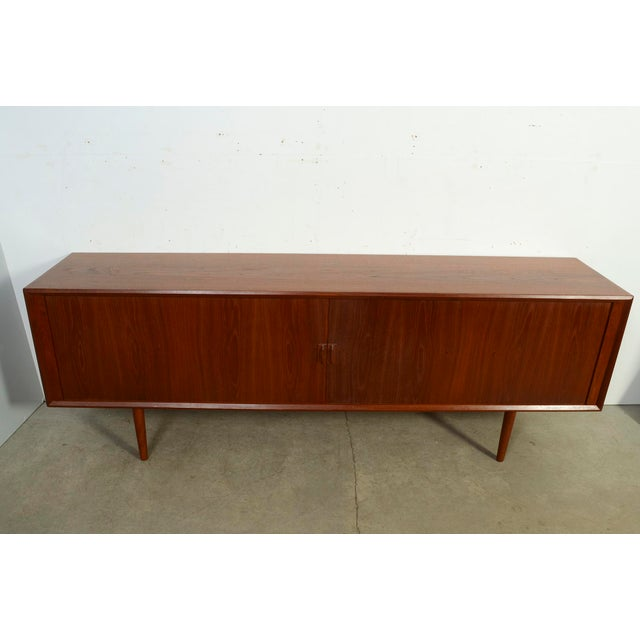 Very impressive Teak credenza or server made by Faarup Mobler it's almost 8 ft. Designed by Svend Aage Larsen for Faarup...
