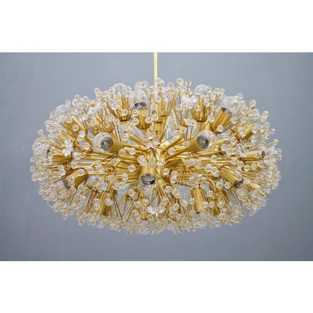 A beautiful and large brass and glass chandelier from the 1960s in a good condition. Measures: Diameter 73 cm (28.7...