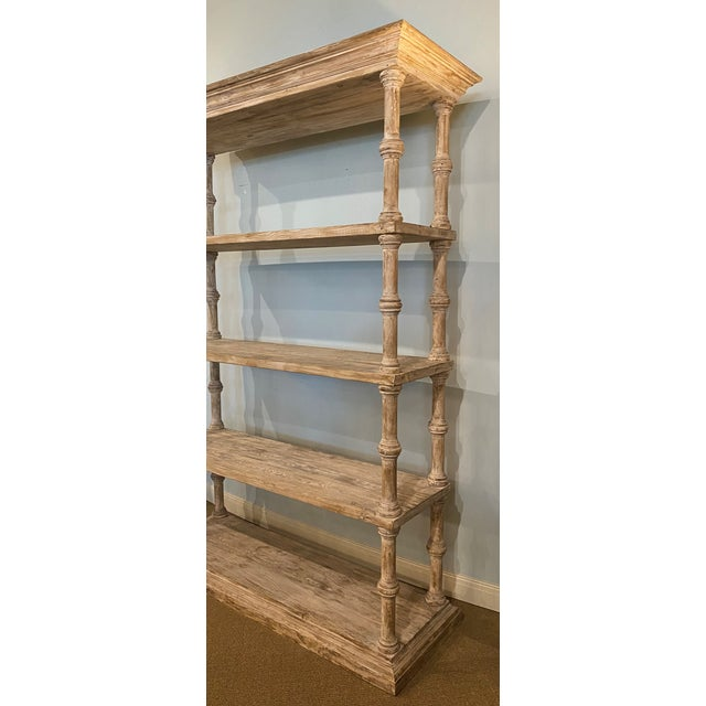 Stunning oversize four shelf etagere with intricate molding at top and bottom in a whitewashed distressed finish.