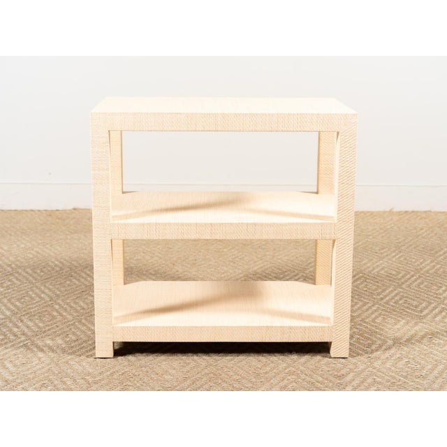 Rectangular side table Three shelves Covered in natural grasscloth
