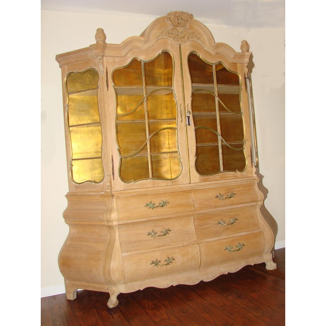 I purchased this breakfront many years ago. The base is constructed with solid wood. I think the piece is Italian. All...
