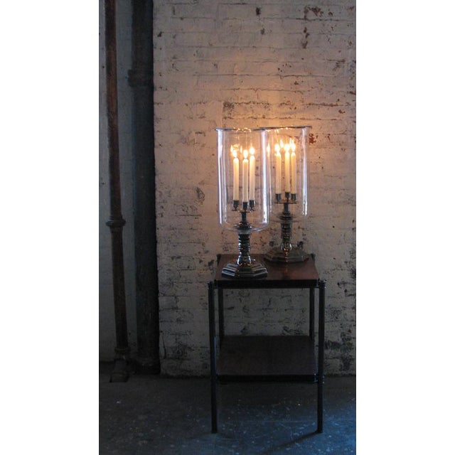 Influenced by the grand Louis XIV style, the large scale Trefoil Hurricane is designed for use with three candles or a...