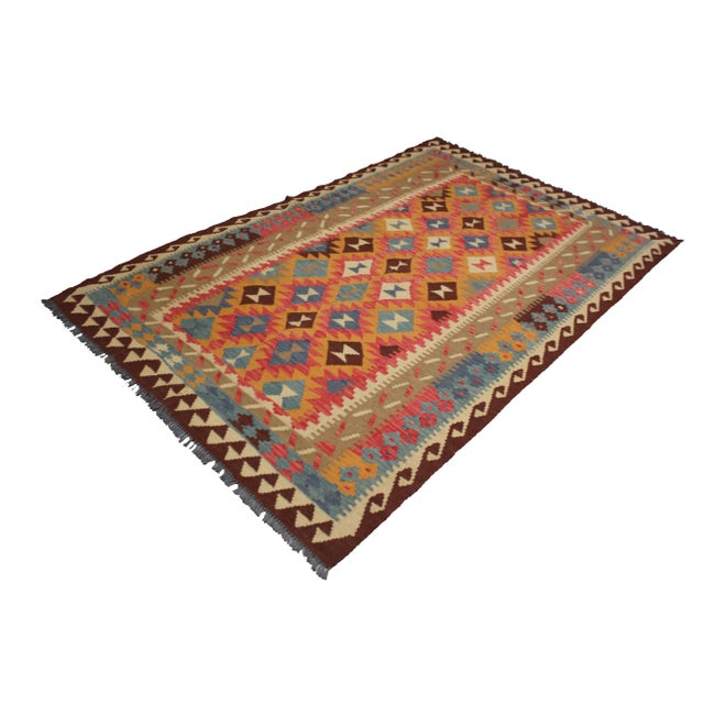 A beautiful traditional kilim, handmade by Aara Rugs. Its colors shine through the design. This kilim is made of 100%...