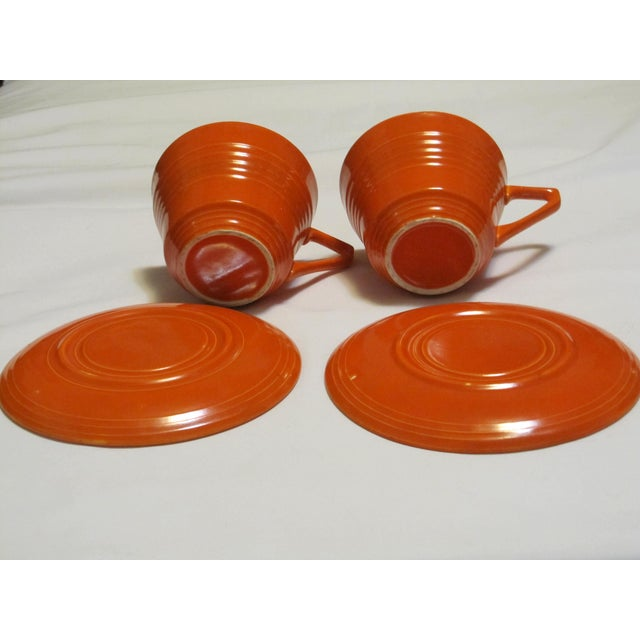 Arts & Crafts Mid-Century Red Harlequin Cups & Saucers - A Pair For Sale - Image 3 of 6