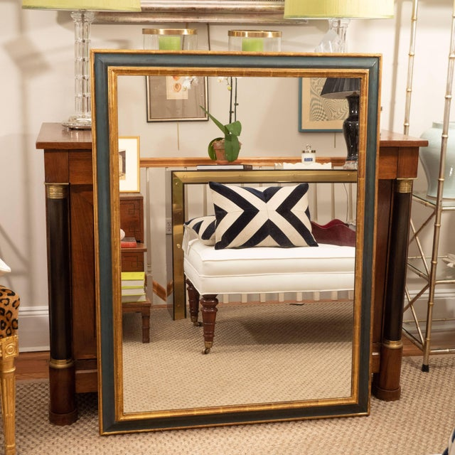 An exceptionally beautiful Italian mirror painted in a stunning blue with a gold leaf inner and outer molding. This mirror...