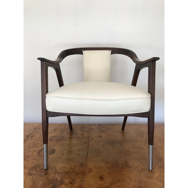 Very comfortable for a long sit. Beautiful seamless lines of a hand crafted chair of solid Walnut newly reupholstered in...