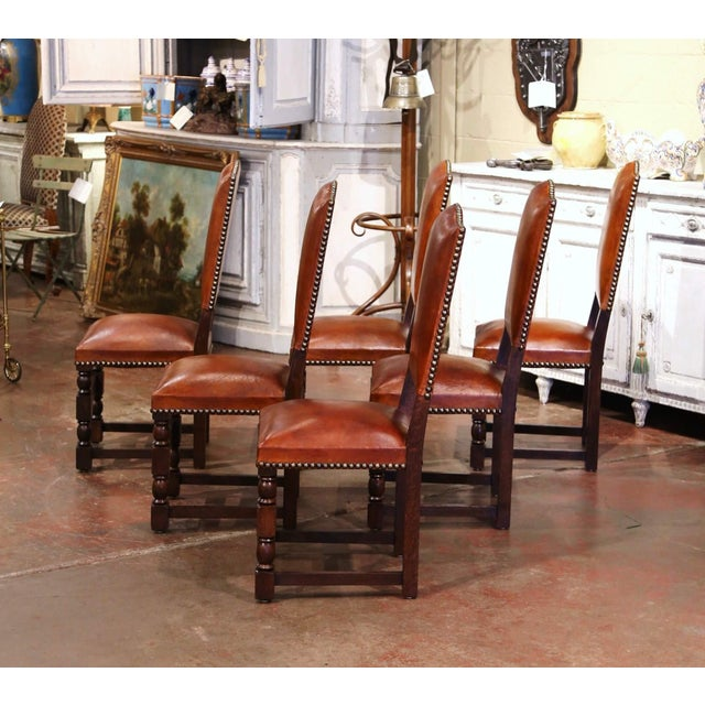 Dress a dining table with this elegant suite of antique chairs. Crafted in France, circa 1880, each side chair stands on...