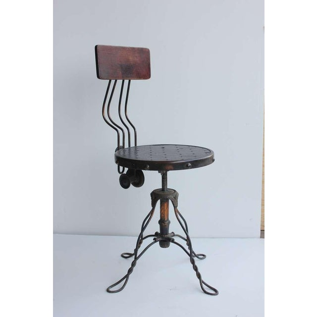 """Beautiful antique swivel desk chair with copper base, wood back and vinyl seat. Seat height is adjustable: H 16.5""""-22.5"""""""