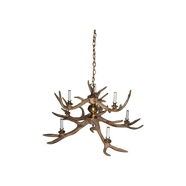 Magnificent and elegant 2-tier hand cast resin antler chandelier with brass appointments in an impressive size. Amazingly...