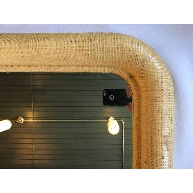 Large Mid-Century Modern glazed or lacquered raffia or grass cloth bullnose mirror. Textured neutral beige/tan tone raffia...