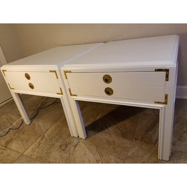 Beautiful pair of campaign style mid-century modern Drexel side tables in excellent condition. The tables are from...