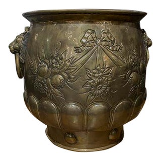 Large English Victorian Brass Jardiniere, With Floral, Ribbon and Swag Repousse Decoration and Brass Lion's Head Ring Handles. For Sale